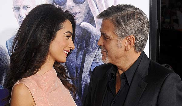 george clooney amal mostra il pancino