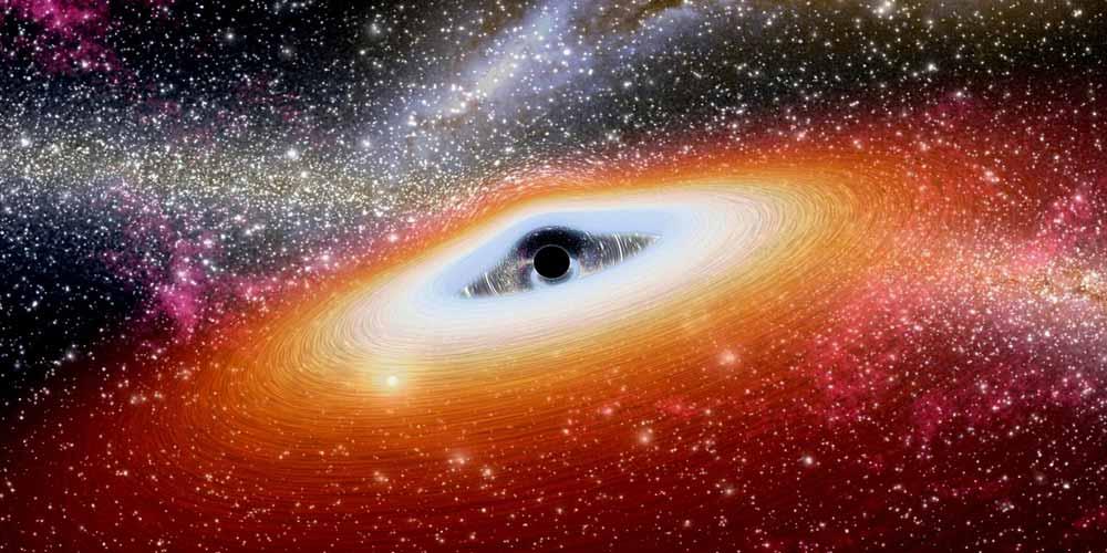 Enorme buco nero oscurato da un oggetto inspiegabile